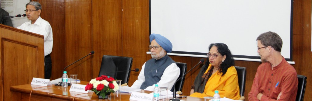Prof. Santosh Panda welcoming Former Indian Prime Minister Dr. Manmohan Singh, Keynote Speaker Prof. Jean Dreze and Dr. Kavita Sharma, President, SAU at the Conference